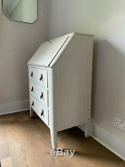 Vintage white-painted bureau chest of drawers with fold-down drop-front desk