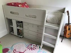 White Mid-sleeper single bed with roll-out desk, chest of drawers, bookshelves